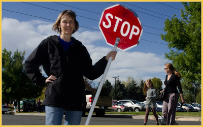 Angie at the cross walk in front of Fireside Elementary